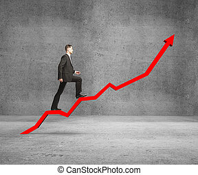 businessman rise on chart on concrete room