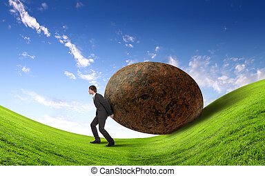 Businessman rolling a giant stone - Image of businessman ...