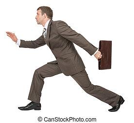 Businessman running forward, side view