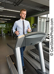 Businessman Running On Treadmill In Gym