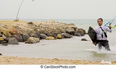 Businessman running out the sea in slow motion