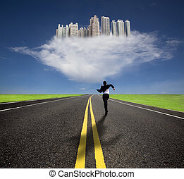businessman running to the future city with his shadow