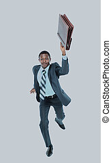 Businessman running with a briefcase, isolated on white background.