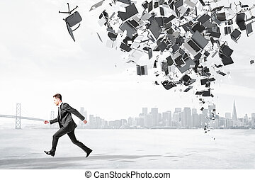 Businessman runs from office garbage heap at city background