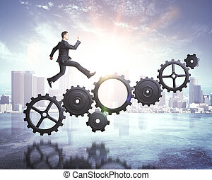 businessman runs on gears on skyscraper background