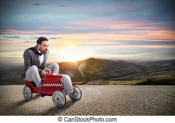 Businessman runs with his car on the road
