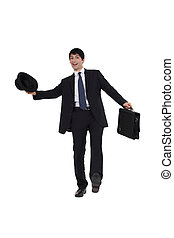 Businessman saluting.