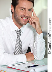 Businessman sat at desk