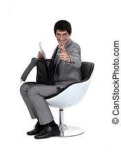 Businessman sat down with briefcase