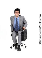 Businessman sat with briefcase