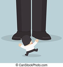 Businessman scared when he standing in front of giant foot