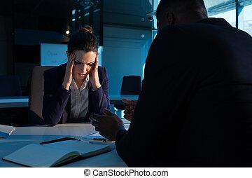 Businessman scolding his colleague at desk