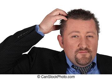 Businessman scratching his head