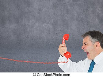 Businessman screaming directly into