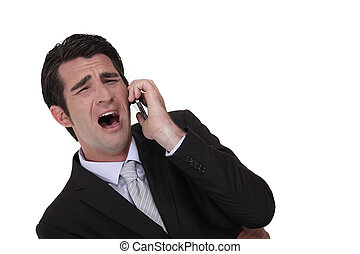Businessman screaming down the phone