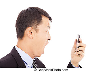 businessman screaming  into  smart phone over white background