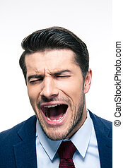 Businessman screaming isolated on a white background