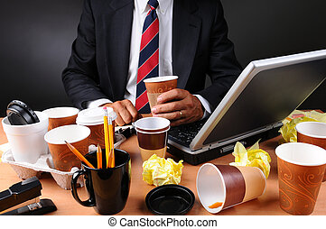 Businessman Seated at His Messy Desk - Closeup view of a ...