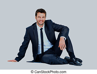Businessman seating isolated over white background.