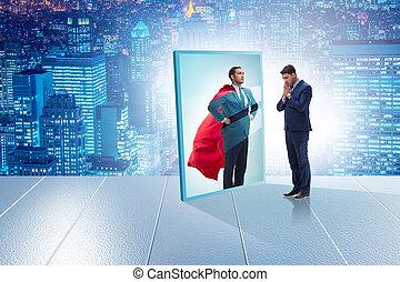 Businessman seeing himself in mirror as superhero