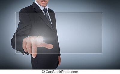 Businessman selecting a transparent screen on grey...