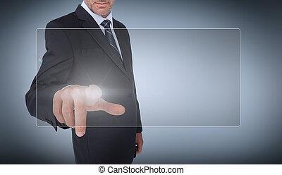 Businessman selecting a transparent screen on grey...