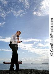 businessman sending a message