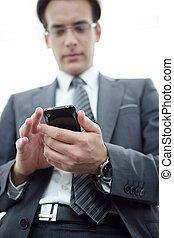 Businessman sending a text message outdoors