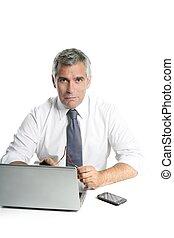 businessman senior gray hair working laptop