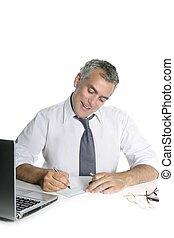 businessman senior signing bank check happy