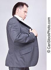 businessman set straight his coat