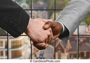Business partners' handshake at daytime. - Businessman shake...