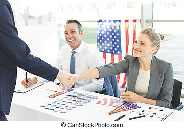 Businessman shaking businesswoman hands during interview session
