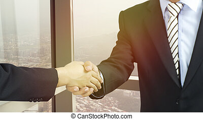 businessman shaking hand in office