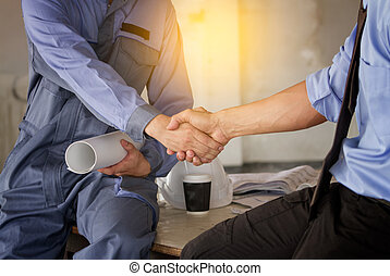 Businessman shaking hands to seal a deal with engineer in constuction site, Business success concept