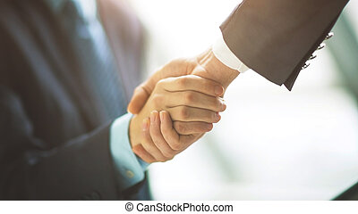 businessman shaking hands to seal deal with his partner