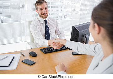 Businessman shaking hands with a colleague