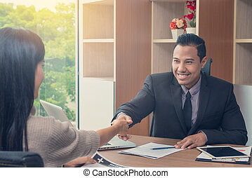 Businessman shaking hands with Businesswoman at meeting or negotiation in the office, Business partnership meeting concept
