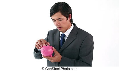 Businessman shaking his piggy bank