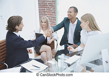 businessman shaking partner hand after successful negotiations