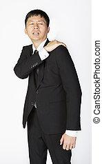 Businessman shoulder pain
