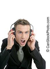 Businessman shout, noisy enviroment, headphones, isolated on white