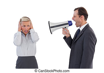 Businessman shouting at colleague w