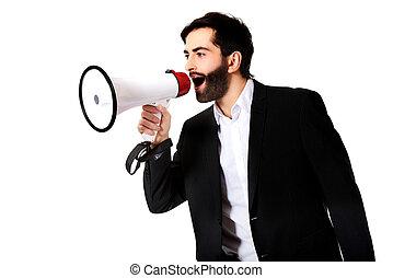 Businessman shouting using a megaphone.