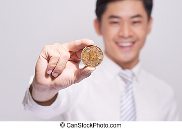 Businessman show bitcoin gold coin. Confident new investment in digital currency exchange and worldwide payment.