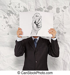 businessman show book of Hand drawn light bulb with IDEA word on crumpled paper as concept