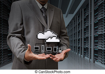 Businessman show cloud network icon on server room...