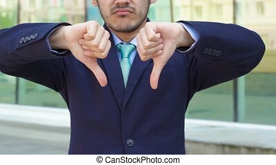 Businessman show gesture disslike standing near office...
