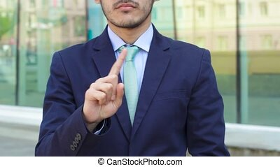 Businessman show gesture No or Do Not pointing by his finger