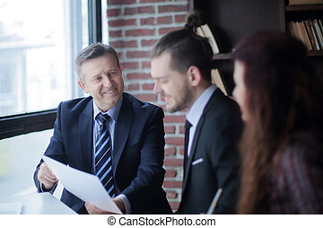 businessman showing a document to the business partner